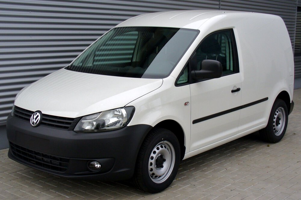 A Volkswagen Caddy van in white